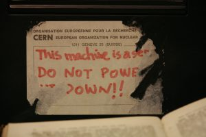 """photo of Tim Berners-Lee's NeXT Cube with a """"server, do not power down"""" sticker on it"""