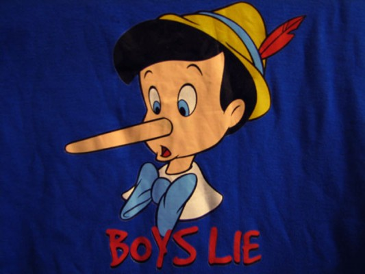 "detail of a t-shirt with a silkscreen printed image of Pinocchio and the text ""Boys Lie"""