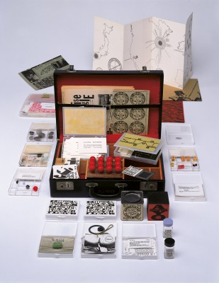 Fluxkit, 1964/65. Fluxus edition, assembled by George Maciunas. Mixed media (vinyl attaché case), printed matter. The Gilbert and Lila Silverman Fluxus Collection, Detroit / Photo: Walker Art Center. All you need to make Fluxus art is in this suitcase.