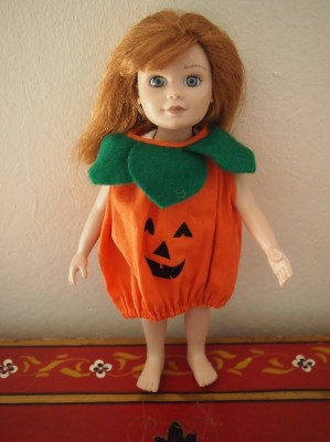 doll Meg in a pumpkin dress