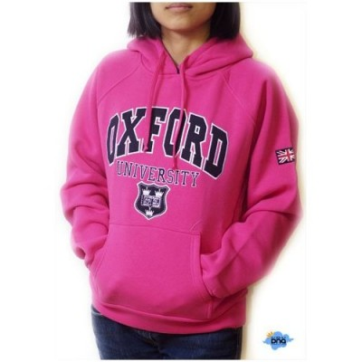 Woman in a pink Oxford University sweatshirt