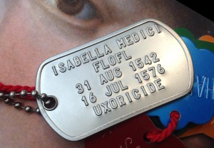 "photo of a dog tag that reads ""Isabella Medici, FLOFL, 31 Aug 1542, 16 Jul 1576, Uxoricide."